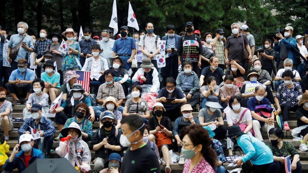 Members of conservative civic groups take part in an anti-government protest, as concerns over a fresh wave of the coronavirus disease (COVID-19) cases grow, in central Seoul