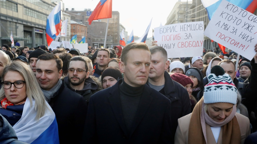 Russian opposition politician Alexei Navalny, his wife Yulia and opposition figure Lyubov Sobol take part in a rally to mark the 5th anniversary of opposition politician Boris Nemtsov's murder