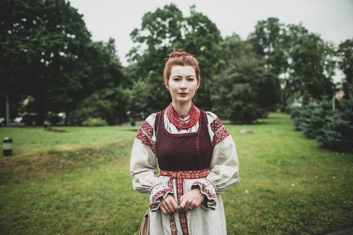 """Olga Baryshnikova, 24, a student and choir singer, wearing the Belarusian national costume. She said she cannot sit silent at a time like this. """"I hurt for Belarus,"""" she said with tears in her eyes. [Evgeniy Maloletka/AP Photo]"""