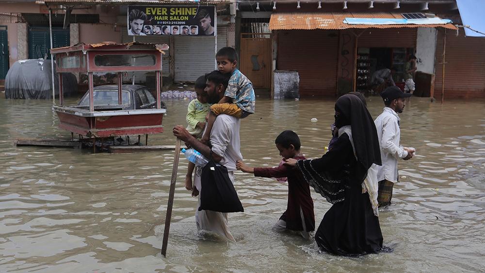 Flooded streets, submerged cars as rain causes havoc in Karachi thumbnail