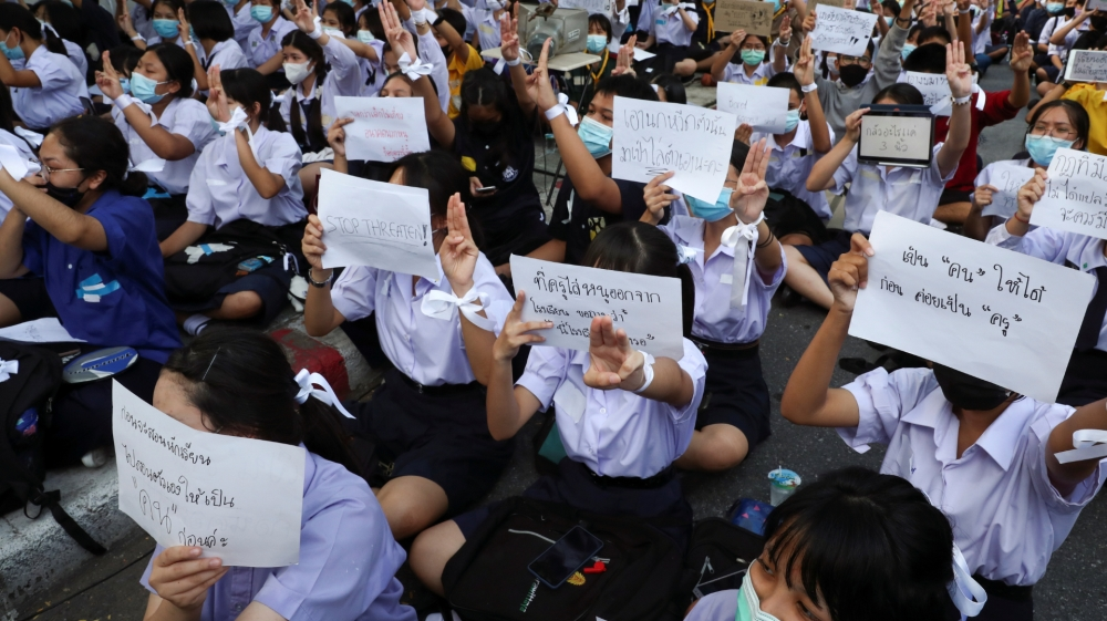 Students show support for the student-led democracy movement outside the Education Ministry in Bangkok