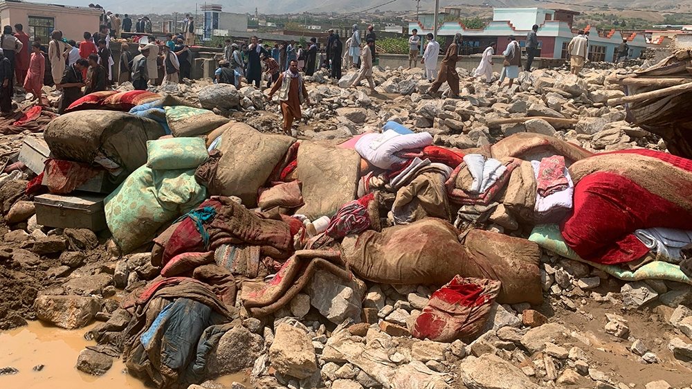 Afghans rescue people after heavy flooding in Parwan province of kabul, Afghanistan, Wednesday, Aug. 26, 2020.Heavy flooding in northern Afghanistan has killed more than two dozen people and injured s