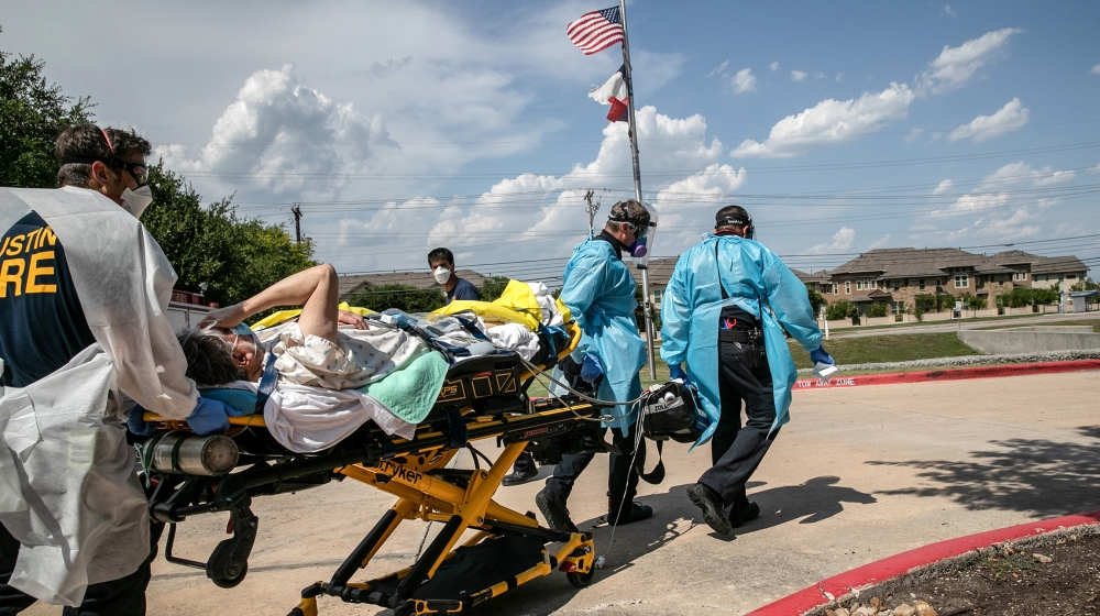 Medics with Austin-Travis County EMS transport a nursing home resident with coronavirus symptoms on August 03, 2020 in Austin, Texas. Texas has had the third-highest number of COVID-19 cases in the Un