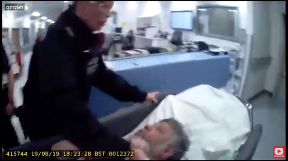 Police violently drag a father from dying daughter's bedside
