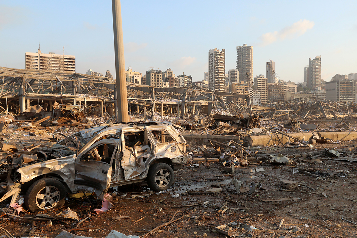 A damaged vehicle is seen at the site of an explosion in Beirut. [Mohamed Azakir/Reuters]