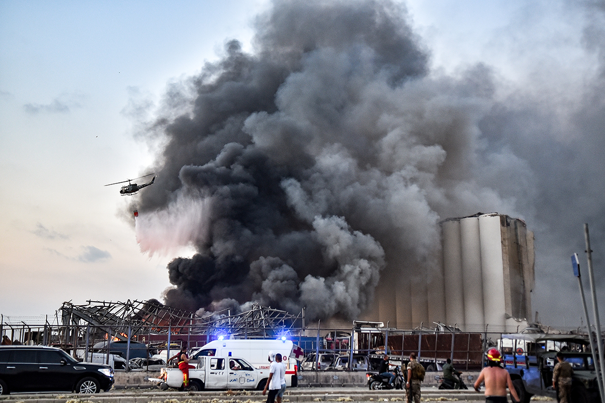A helicopter puts out a fire at the scene of an explosion at the port of Lebanon''s capital Beirut. [AFP]