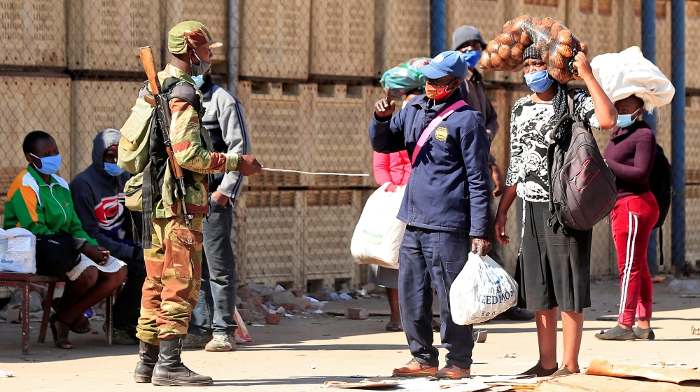 A soldier checks pedestrians ahead of planned anti-government protests during the coronavirus disease (COVID-19) outbreak in Harare, Zimbabwe, July 30, 2020. REUTERS/Philimon Bulawayo