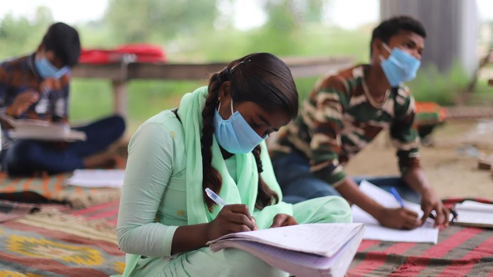 Study in an open-air class in Delhi