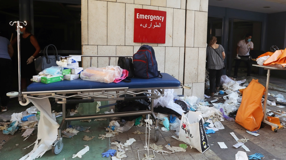 Protective gloves are scattered on the ground at a damaged hospital following Tuesday's blast in Beirut, Lebanon August 5, 2020. REUTERS/Mohamed Azakir