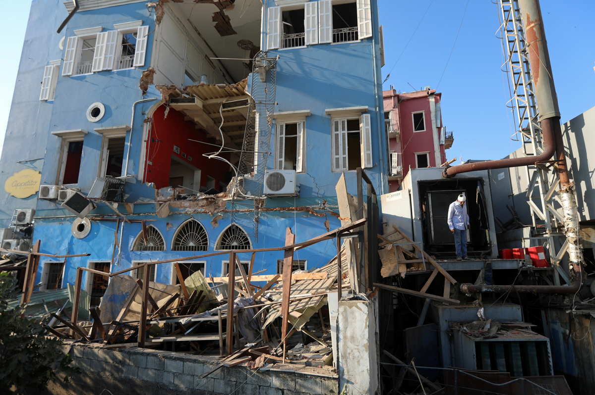 A man inspects the damage following Tuesday's blast in Beirut's port area, Lebanon August 5, 2020. REUTERS/Mohamed Azakir