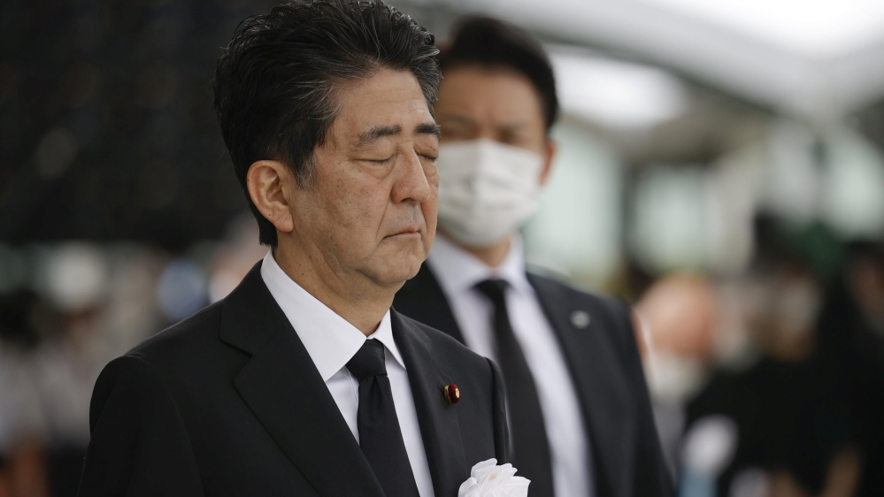 Japan's Prime Minister Shinzo Abe offers a silent prayer for the victims of the 1945 atomic bombing, at Peace Memorial Park in Hiroshima, Japan