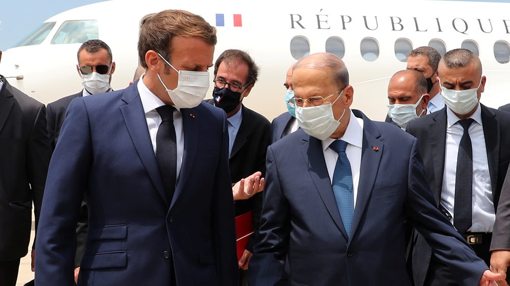 Lebanon's President Michel Aoun welcomes French President Emmanuel Macron upon his arrival at the airport in Beirut, Lebanon August 6, 2020. Dalati Nohra/Handout via REUTERS ATTENTION EDITORS - THIS I