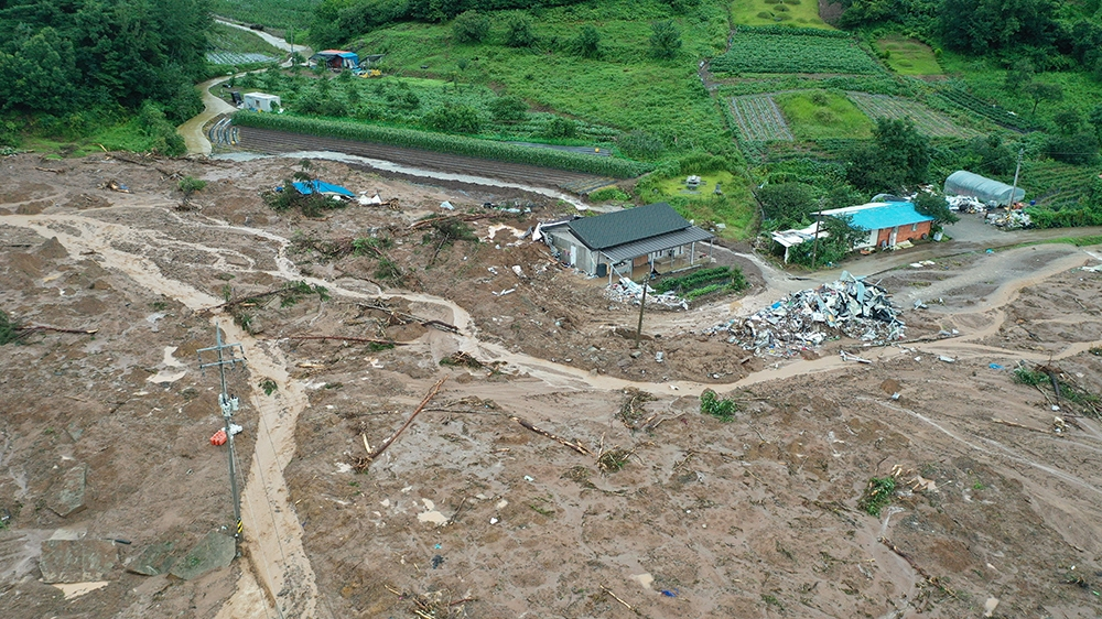 epa08591202 A general aerial view of a village that was devastated by a landslide the previous day,  in the southwestern county of Gokseong, South Korea, 08 August 2020. Five people were killed by the