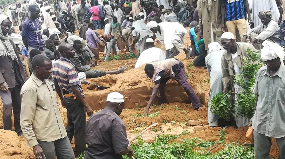 Residents dig a mass grave for victims of an attack that left over 60 dead in the village of Masteri in west Darfur, Sudan Monday, July 27, 2020. A recent surge of violence in Darfur, the war-scarred