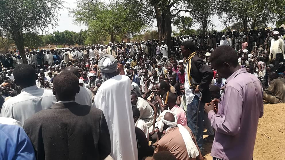 Residents gather in mass funeral after an attack in the village of Masteri in west Darfur, Sudan Monday, July 27, 2020. A recent surge of violence in Darfur, the war-scarred region of western Sudan, h