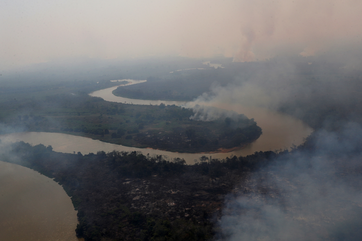 An aerial view shows smoke rising into the air around the Cuiaba river in the Pantanal, the world's largest wetland, in Pocone, Mato Grosso state, Brazil. [Amanda Perobelli/Reuters]