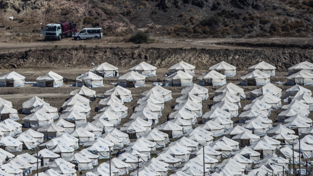 A general view of the temporary camp for refugees and migrants near Mytilene town, on the northeastern island of Lesbos, Greece, Sunday Sept. 13, 2020. Greek authorities have been scrambling to find a