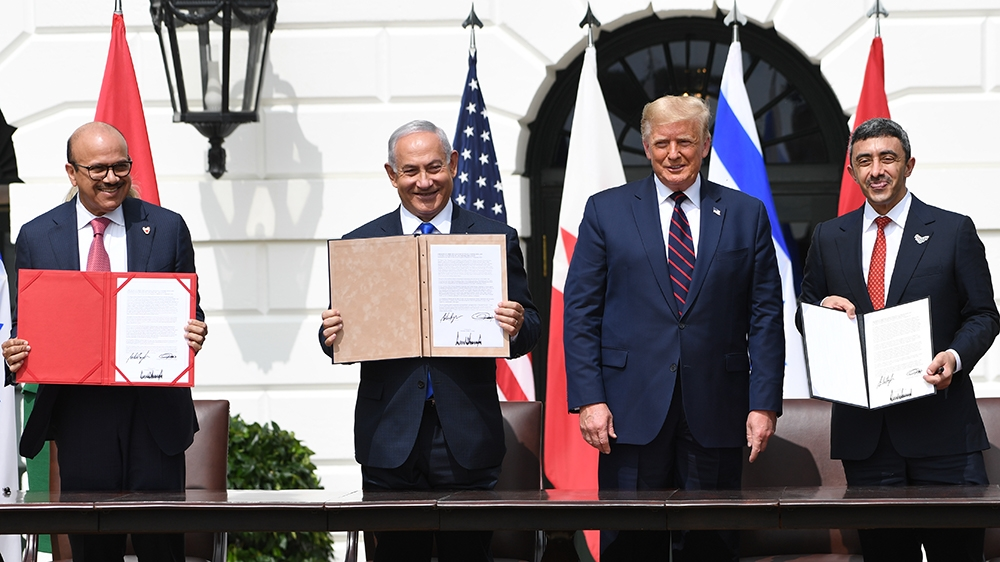 (L-R)Bahrain Foreign Minister Abdullatif al-Zayani, Israeli Prime Minister Benjamin Netanyahu, US President Donald Trump, and UAE Foreign Minister Abdullah bin Zayed Al-Nahyan participate in the signi