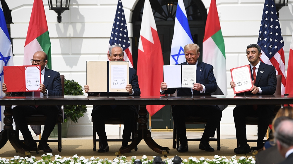 (L-R)Bahrain Foreign Minister Abdullatif al-Zayani, Israeli Prime Minister Benjamin Netanyahu, US President Donald Trump, and UAE Foreign Minister Abdullah bin Zayed Al-Nahyan hold up documents as the