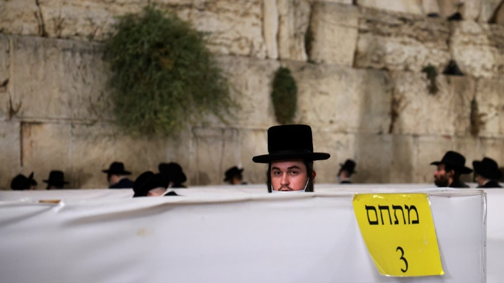 Ultra Orthodox Jews keep social distancing inside dividing cells while participating in the Slichot (forgiveness) prayer, the last prayer on the eve of Rosh Hashana, the Jewish New year,