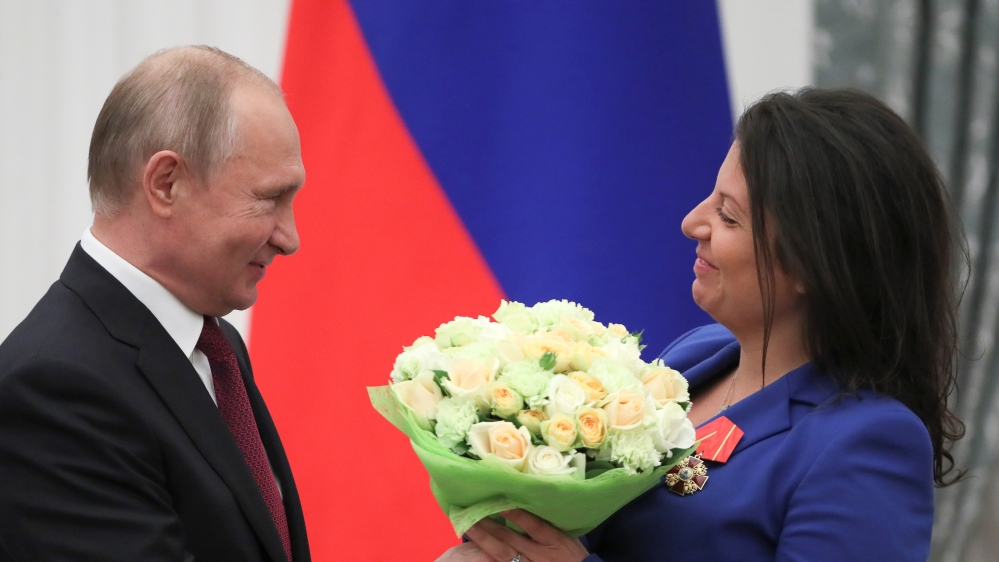 Russian President Putin and editor-in-chief of broadcaster RT Simonyan attend an awarding ceremony in Moscow