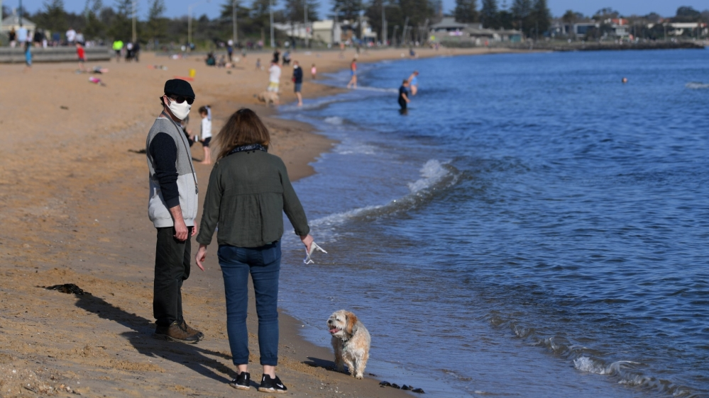 Australia records fewest coronavirus cases since June: Live news