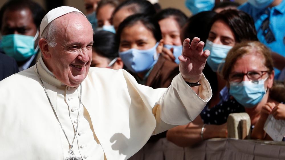 Pope Francis leaves after the first weekly general audience to readmit the public since the coronavirus disease (COVID-19) outbreak, at the Vatican