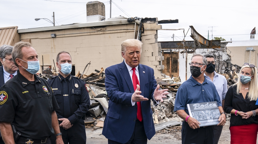President Donald Trump tours an area on Tuesday, Sept. 1, 2020, damaged during demonstrations after a police officer shot Jacob Blake in Kenosha, Wis. (AP Photo/Evan Vucci)