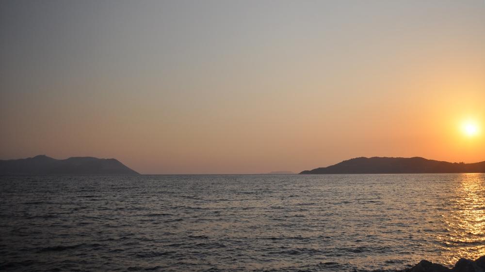 Sun sets on Turkey (right) and Kastellorizo (left) [Samuel Kent/Al Jazeera]