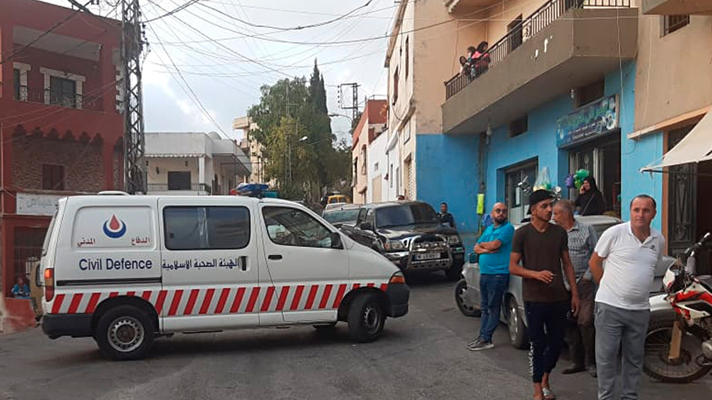 A Hezbollah civil defense ambulance block a road that leads to the site of an explosion that rocked a Hezbollah stronghold, in the southern village of Ain Qana, Lebanon, Tuesday, Sept. 22, 2020. The p