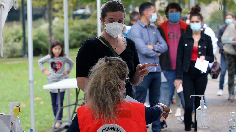 People arrive at a coronavirus testing centre in Bayonne, southwestern France, Tuesday, Sept. 22, 2020. France is reporting several thousand virus cases a day and more than 80 weekly cases per 100,000