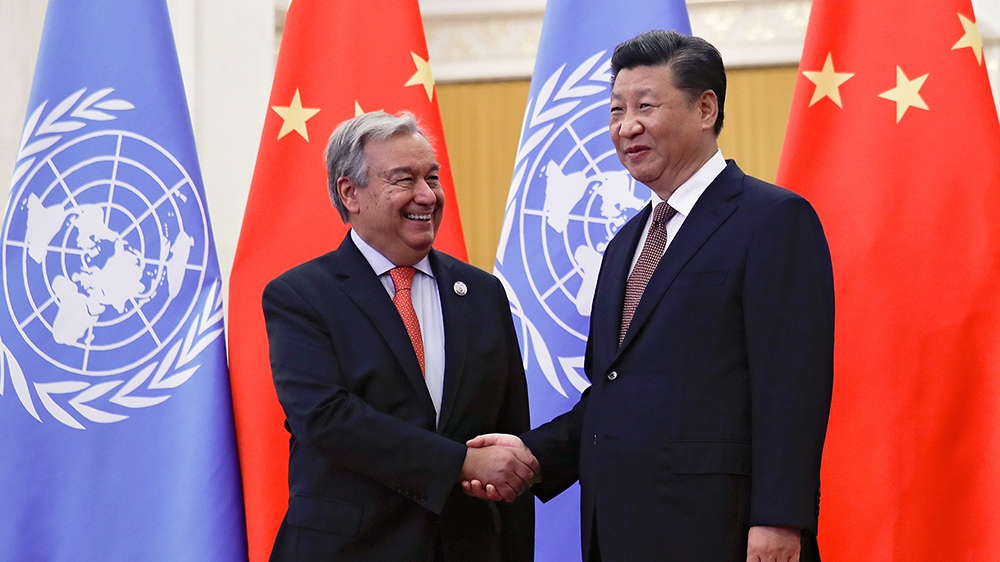 FILE PHOTO: United Nations Secretary General Antonio Guterres shakes hands with China's President Xi Jinping before proceeding to their bilateral meeting at the Great Hall of the People in Beijing, Ch