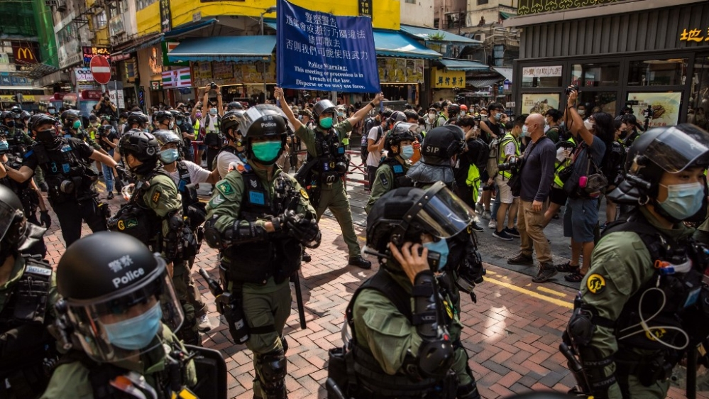 Pro-democracy protesters march during a demonstration oppose postponed elections, in Hong Kong