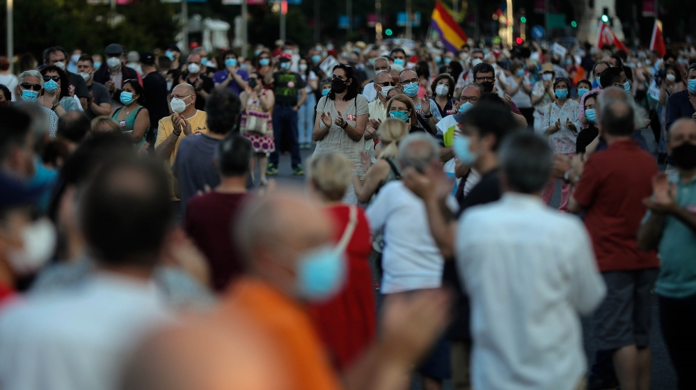 Protesters demand social structuring after pandemic in Madrid