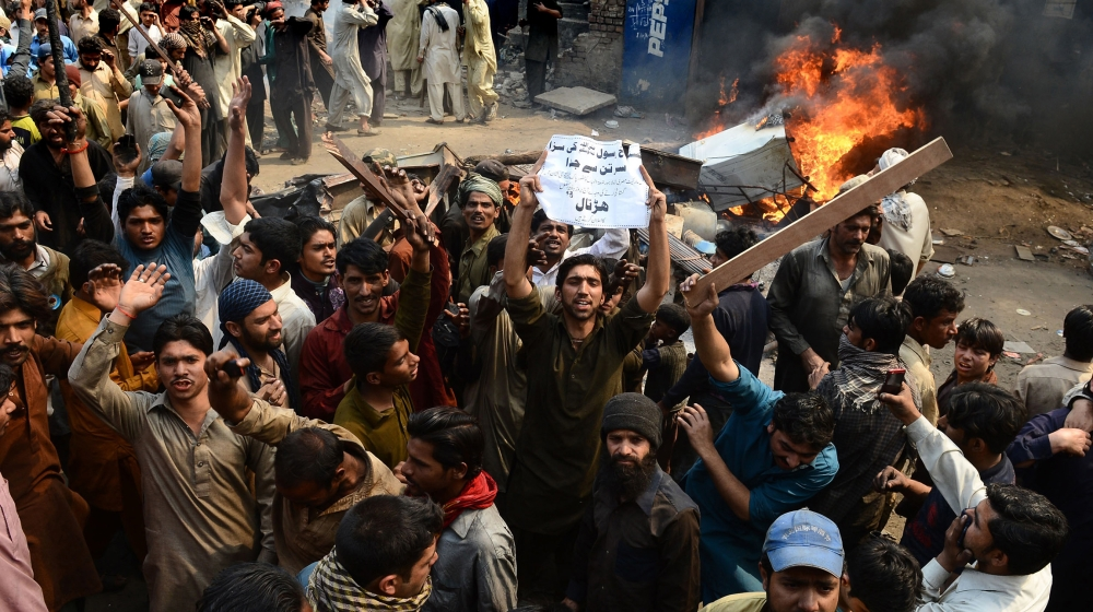 Angry Pakistani demonstrators shout slogans during a protest over alleged blasphemous remarks by a Christian in a Christian neighborhood in Badami Bagh area of Lahore on March 9, 2013. Thousands of an