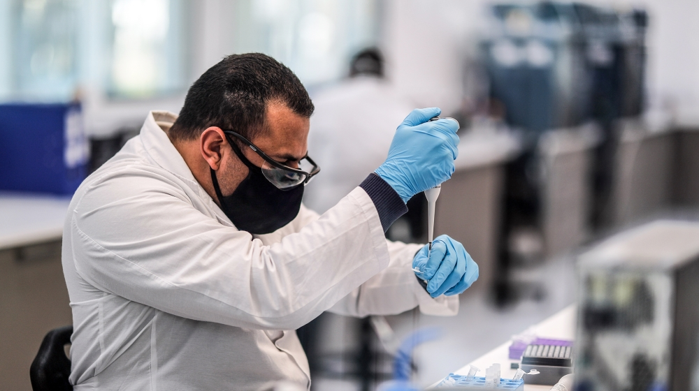 Workers of the mAbxience laboratory, chosen by AstraZeneca for the production in Latin America of the vaccine against COVID-19, carry out tasks in the plant that the company owns in Garin, in the prov