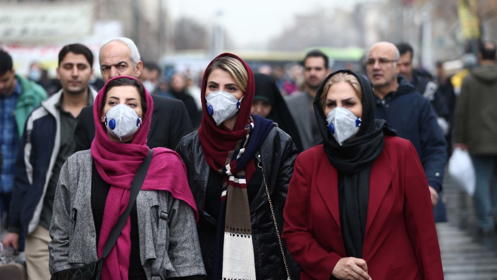 Iranian women wearing protective masks to prevent contracting a