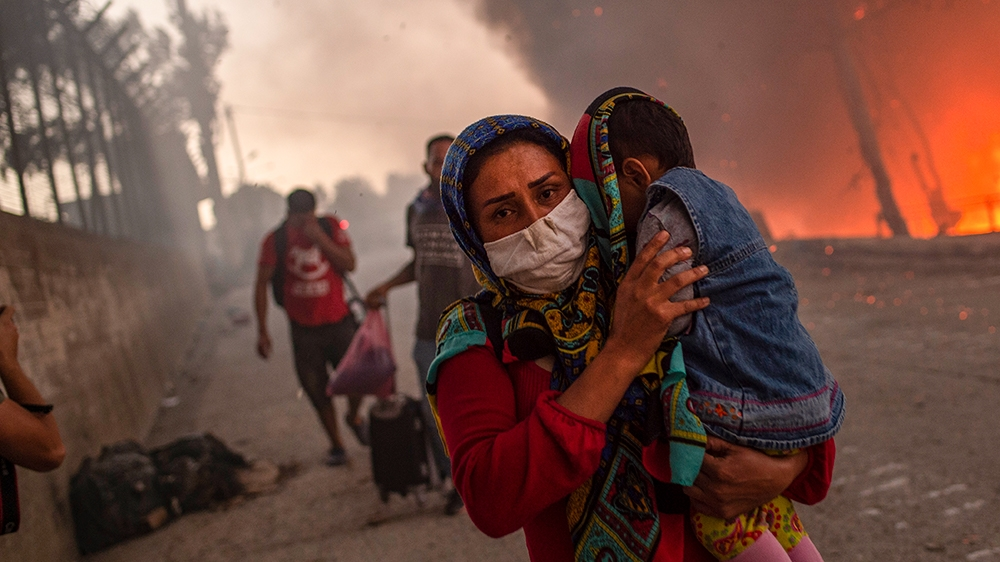 Who should look after refugees displaced by Greece camp fire? thumbnail