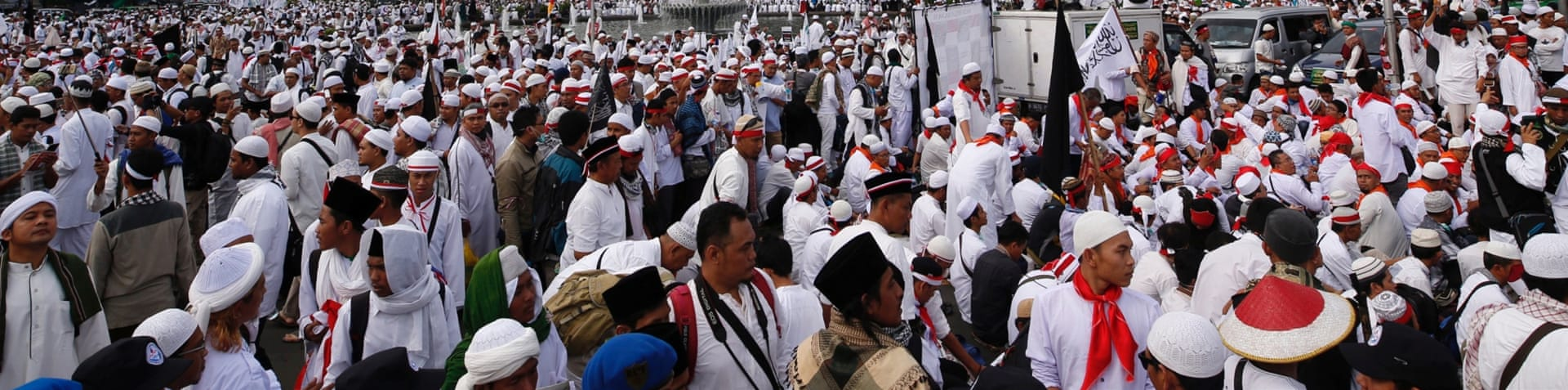 Crowds waved 'We Are Indonesia' signs and held a giant red-and-white national flag [Reuters]