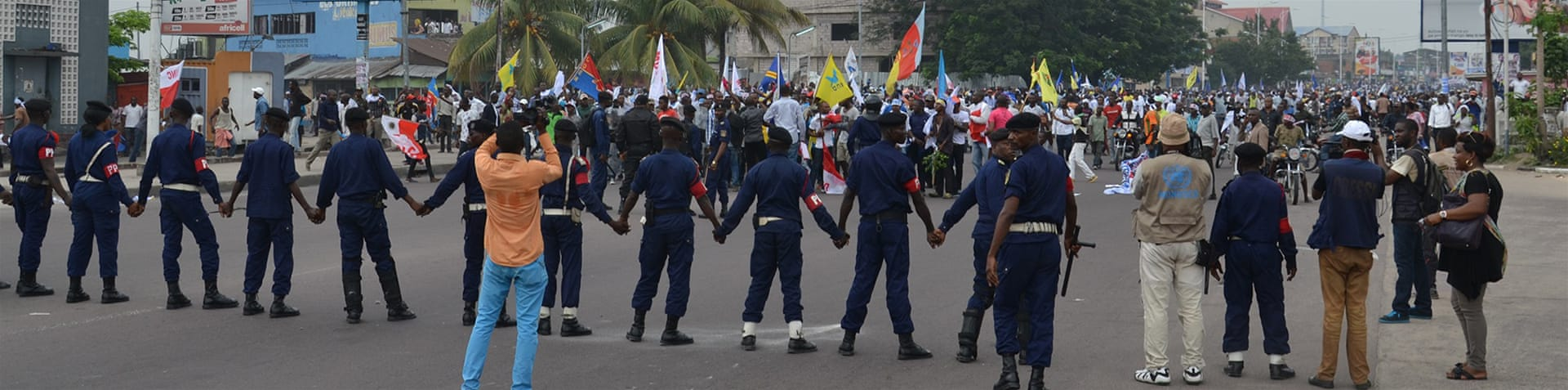 Security forces fired tear gas and charged at several thousand stone-throwing protesters in Kinshasa [Habibou Bangré/Al Jazeera]