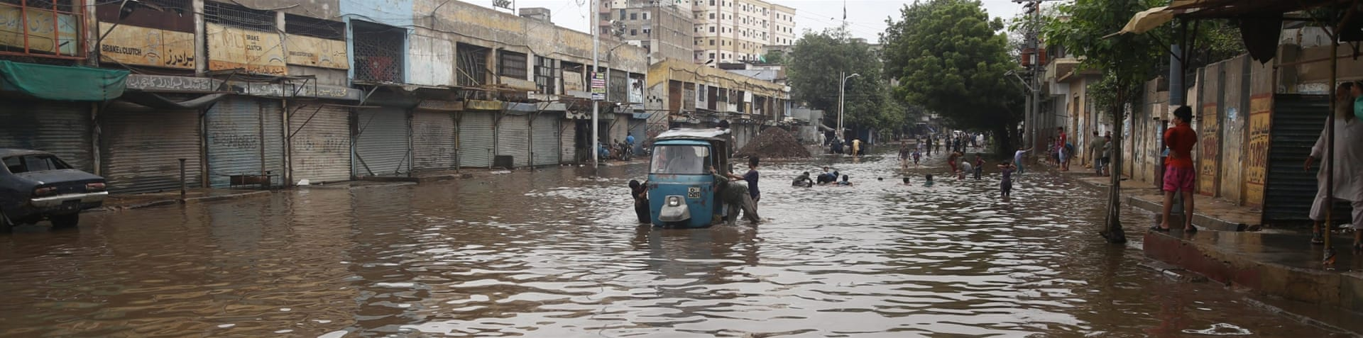 The flooding has left 45 percent of Karachi without power [Rehan Khan/EPA]