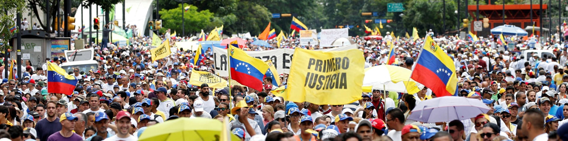 Hundreds of thousands march through the streets of Caracas to demands a recall vote against President Maduro [Reuters]