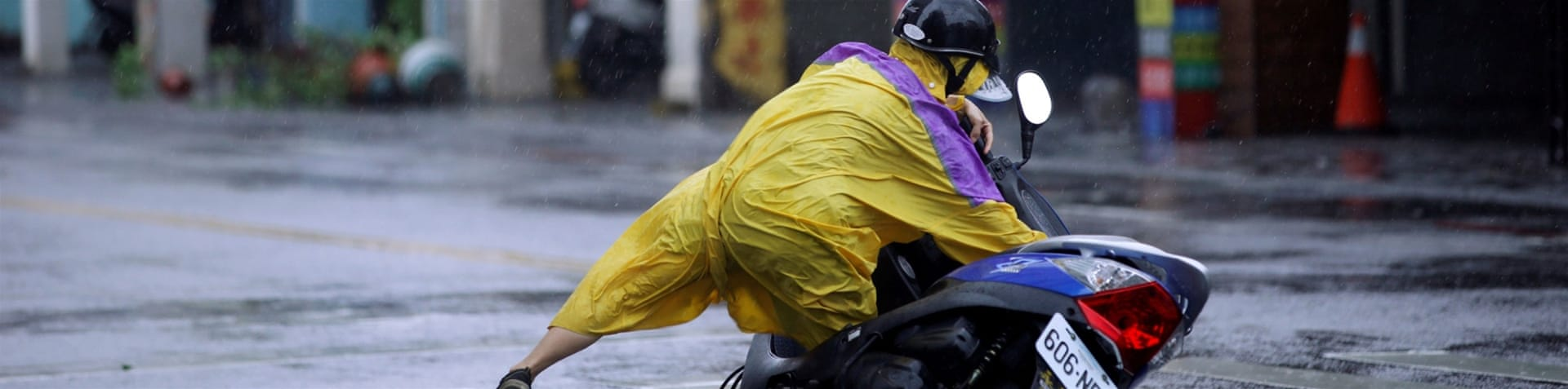Taipei is swept by wind and rain from Typhoon Megi, passing to the south [AFP]