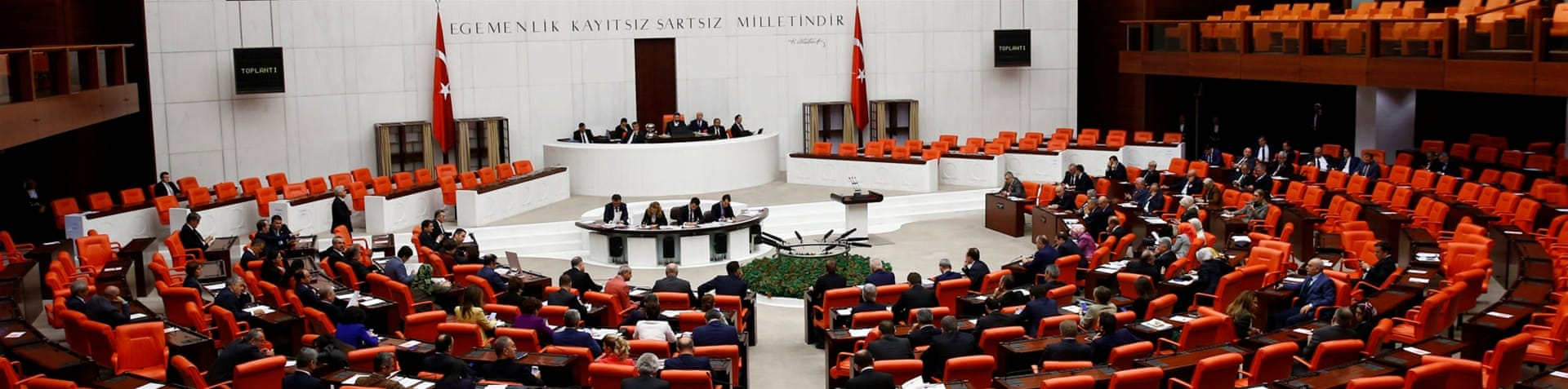 Binali Yildirim, the Turkish prime minister votes with MPs during a debate on the proposed constitutional changes [Umit Bektas/Reuters]