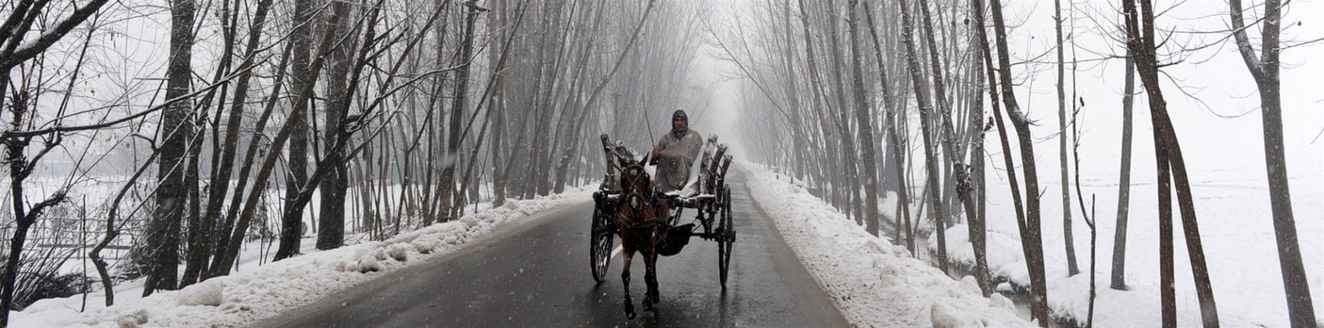 Dal lake during snowfall in Srinagar, the summer capital of Indian-administered Kashmir [EPA]