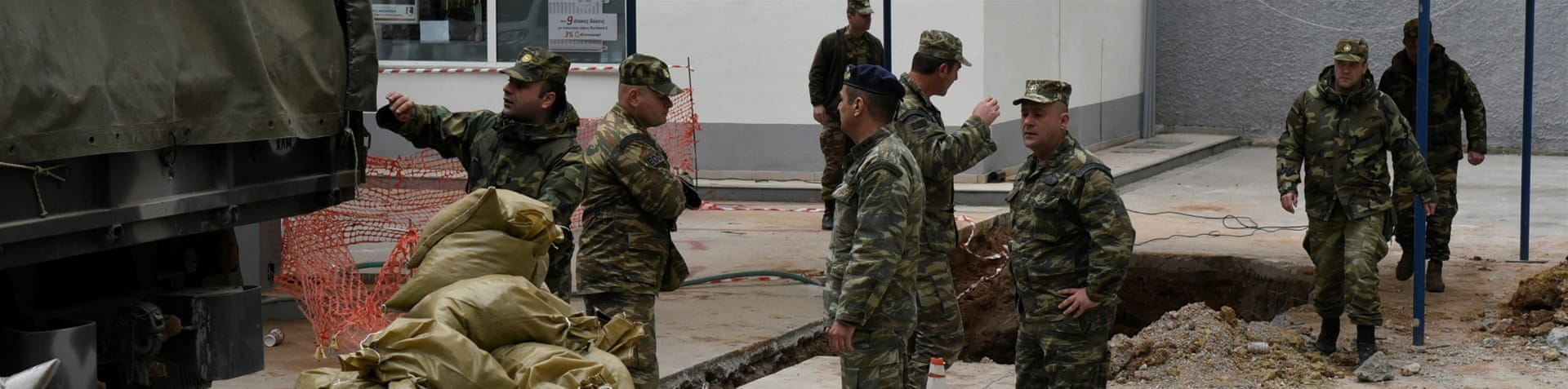 The 250kg bomb was discovered about 5 metres below ground [Giannis Papanikos/AP]