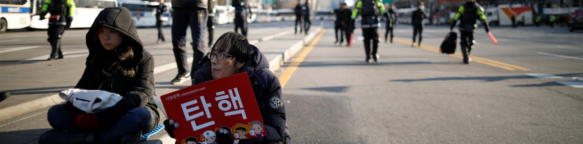 Anti-Park protesters in Seoul marched in three directions on Saturday [EPA]