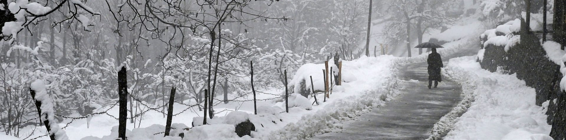 A late flurry of fresh snow covered the outskirts of Srinagar, the summer capital of Indian-administered Kashmir [EPA]