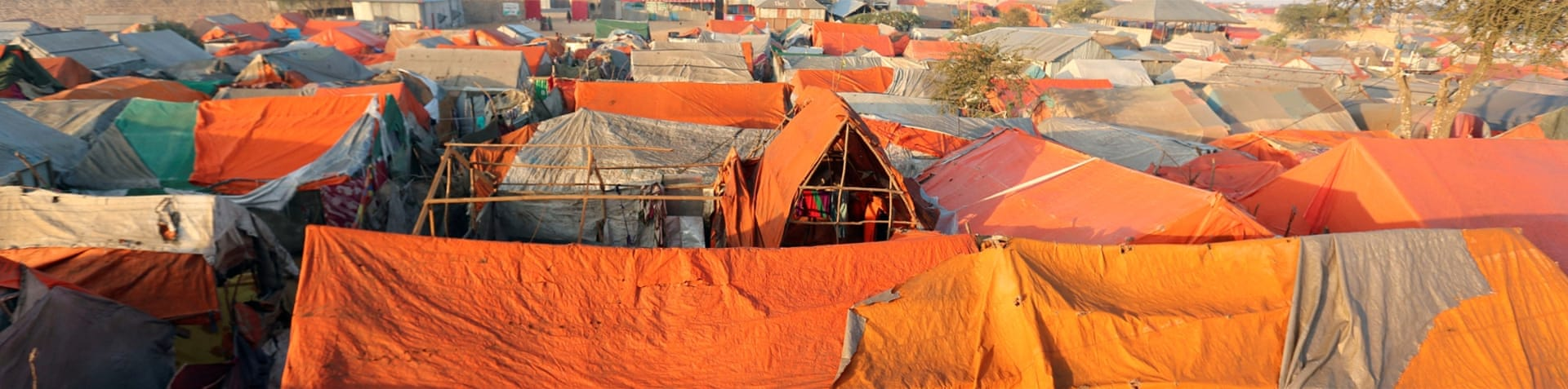IDP camps are faced with a shortage of food amid a national disaster [Feisal Omar/Reuters]