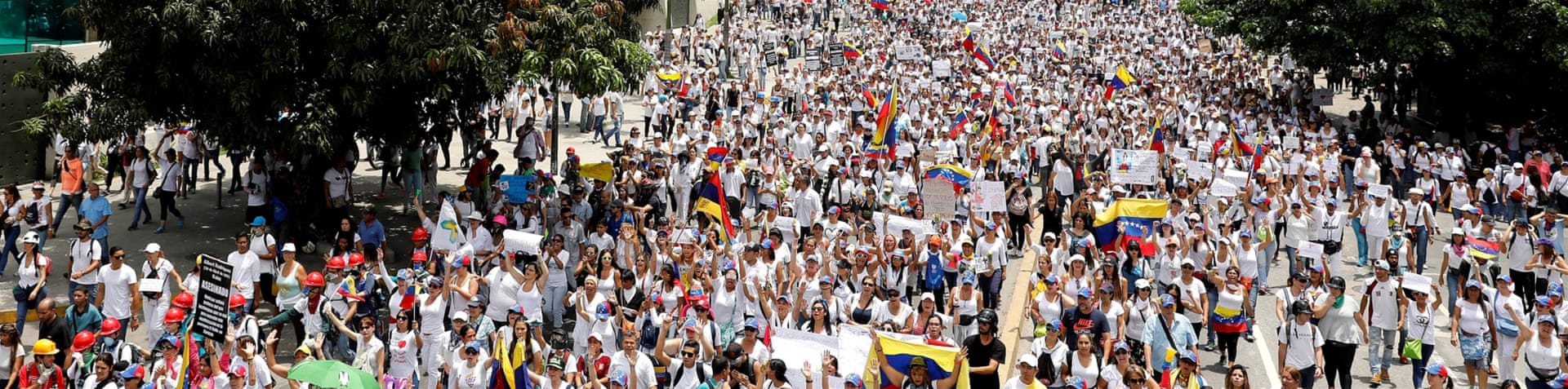 Women marching in Caracas against President Nicolas Maduro's government [Carlos Garcia Rawlins/Reuters]